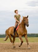 image of girth  - young girl riding horse - JPG