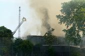 DAYTON, OHIO - AUGUST 15: Firefighters battle an old, abandoned warehouse fire through billowing smo