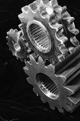 stock photo of time machine  - standing mechanism of gears against velvet in black - JPG
