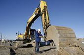 stock photo of jcb  - driver examining scoop on bulldozer - JPG