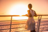 Cruise ship vacation woman travel watching sunset at sea ocean view. Elegant lady in white dress rel poster