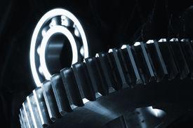 picture of mechanical engineer  - gears mechanism in blue against black velvet idea - JPG