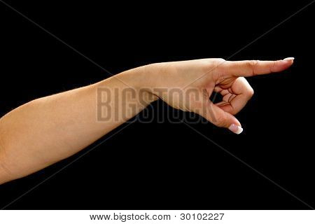 Female hand with pointing finger over black background