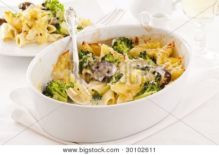 casserole with pasta, broccoli and cheese