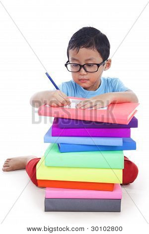 Asian kid working with books