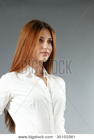 Sexy happy smiling brown-haired girl in white shirt. Side view. Portraits collection.