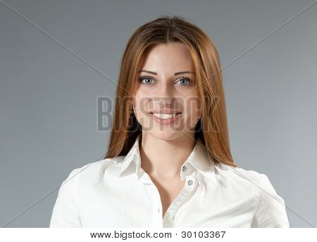 Sexy happy smiling brown-haired girl in white shirt. Front view. Portraits collection.