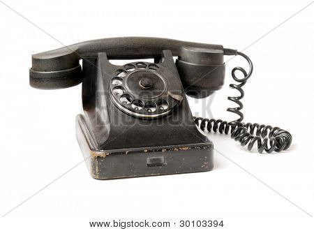 Old black telephone isolated on white background.