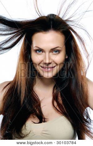 beauty model in studio with hair blown by wind