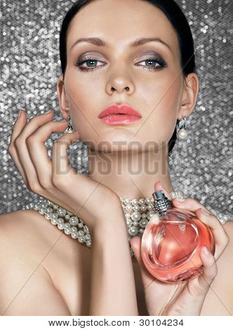 Beauty with perfume on sparkling background