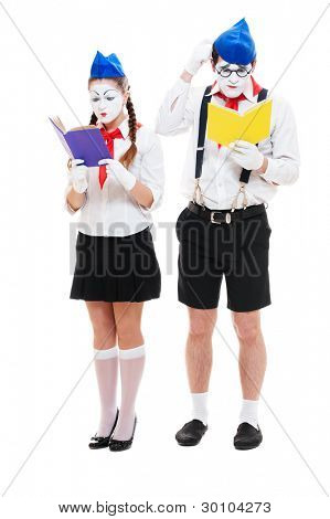 portrait of reading mimes with books. isolated on white background
