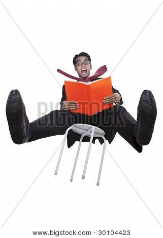 Businessman Falling From A Chair