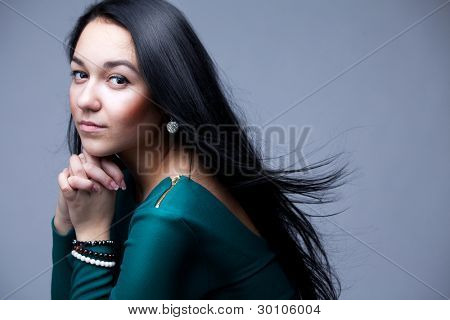 portrait of beautiful woman with black long hairs