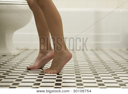 Child's Feet on Tile Floor