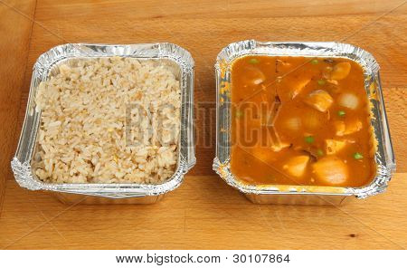 Chinese chicken curry and egg fried rice takeaway meal