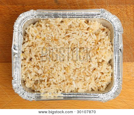 Chinese egg-fried rice in takeaway container.