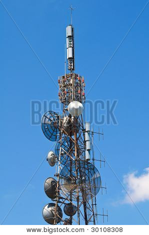 Communication tower over a blue sky.