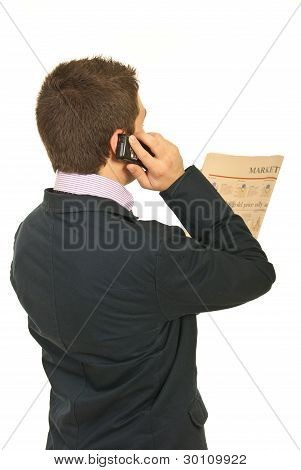 Back Of Business Man Reading News