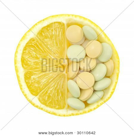 Close up of lemon and pills isolated