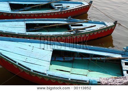 Colorful Boats On Brown Waters Of Ganges River, Varanasi, India