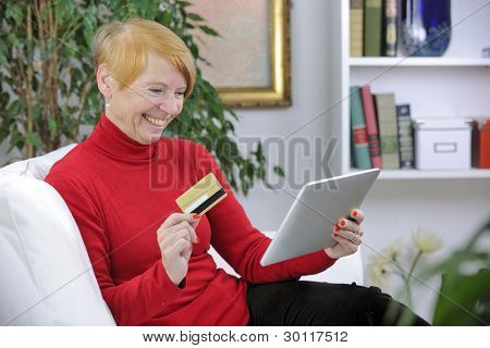 senior woman shopping online with digital pad