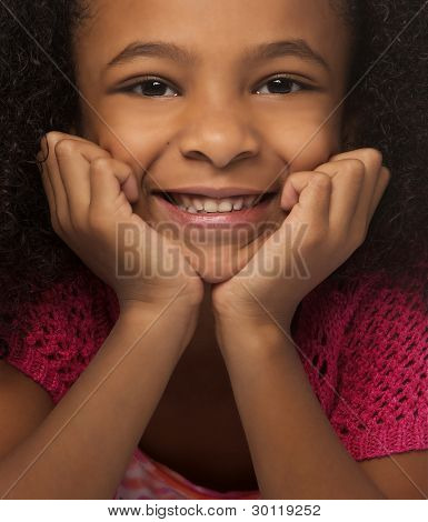 Close up photo of pretty little girl smiling.