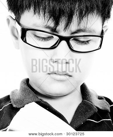 Child Improving His Education By Reading A Book