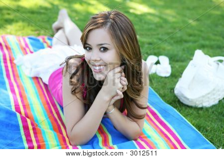 Cute Teenager In Park