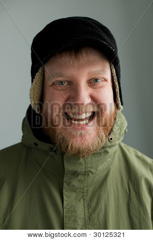 Smiling Man In A Hat