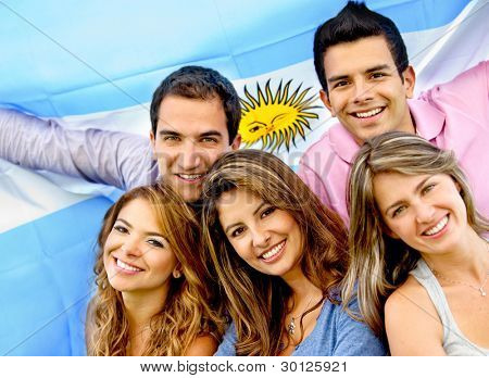 Argentinean group of people with the flag of Argentina