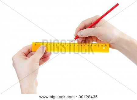 yellow centimeters ruler and red pencil in hands isolated on white