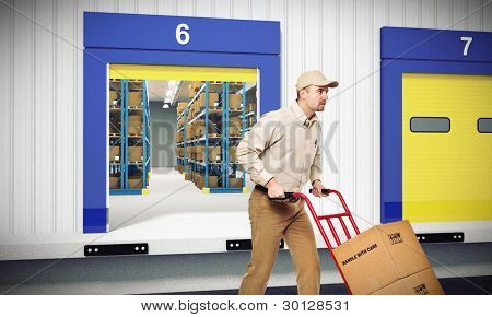 young worker on duty and warehouse background
