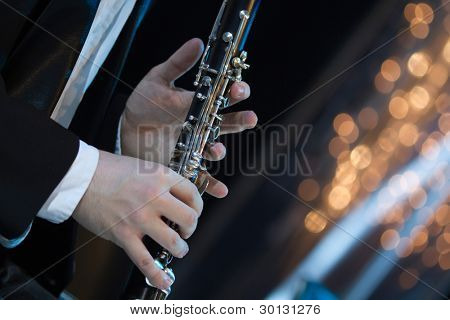 Solo clarinet player performing live on stage