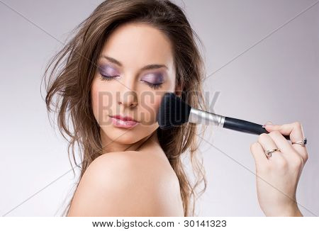 Young Brunette Getting Makeup, With Brushes.