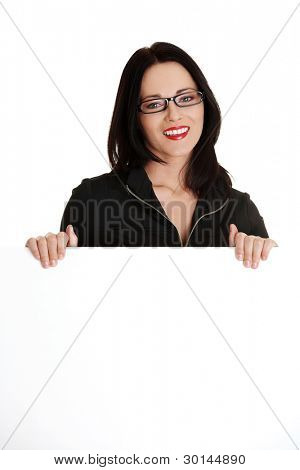 Businesswoman holding blank white board, isolated on white background