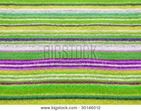 Vibrant alpaca striped texture closeup.