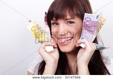 Joyful Young Woman With Her Hands Full Of Euros