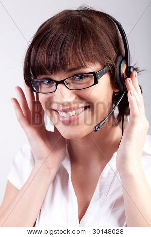 Portrait Of A Happy Customer Support Employee / Secretary