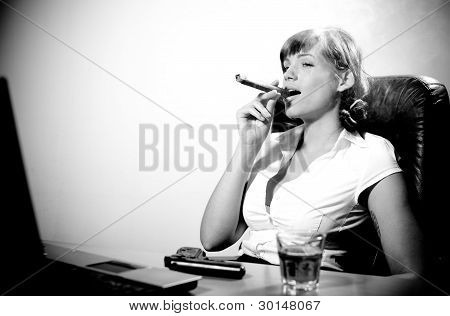 Cool Businesswoman Relaxing. Smoking A Fat Cigar And Drinking Whiskey.
