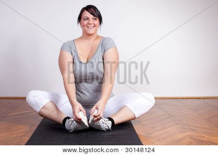 Cheerful Overweight Woman Exercising/stretching