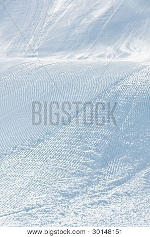 Alpine Ski Piste With Ski And Snowboard Tracks