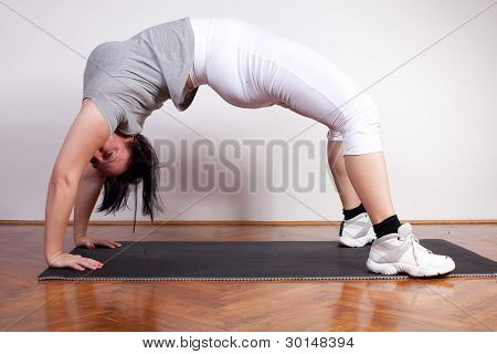 Overweight Woman Exercisin/stretching At Home