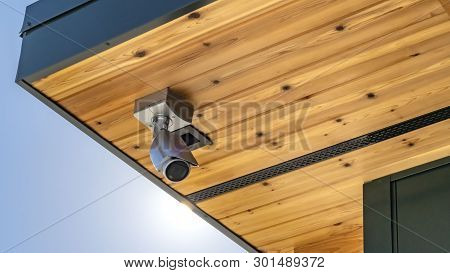 poster of Panorama Home With Security Camera Installed On The Wooden Underside Of Its Roof