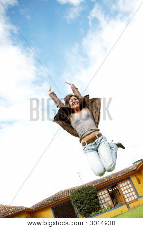 Happy Woman Jumping And Smiling
