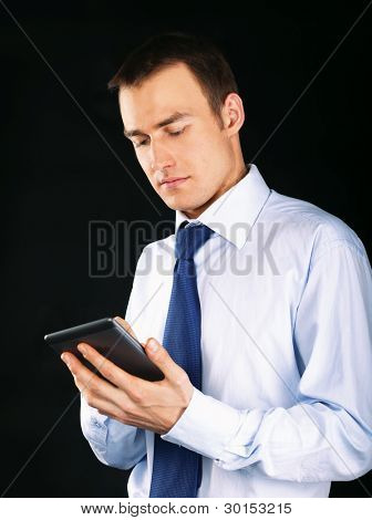 Young adult working on a digital tablet, isolated on white background