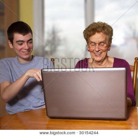 Grandson And Grandmother At A Laptop