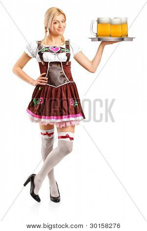 Full length portrait of a woman wearing traditional costume and holding three beer glasses isolated on white background