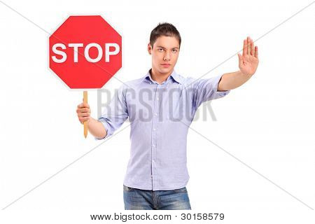 A man gesturing and holding a traffic sign stop isolated against white background