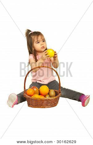 Toddler Girl Giving Apple From Basket