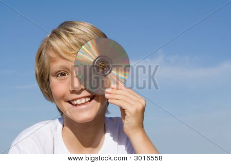 Child With Cd Or Dvd Disc